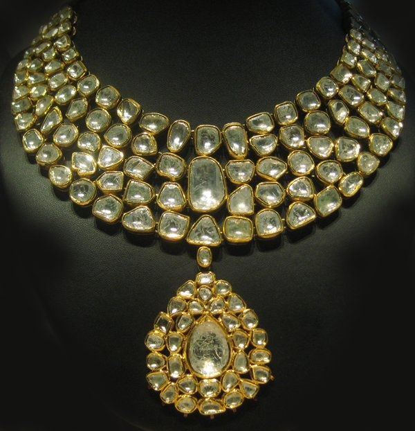 https://www.bkgjewelry.com/sapphire-ring/349-18k-yellow-gold-diamond-blue-sapphire-solitaire-ring.html Kundan and Polki (uncut diamonds) Jewelry.