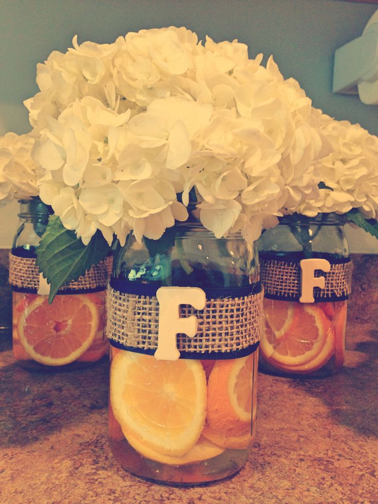 with lemons instead of oranges :)  Wedding shower centerpieces---love this so fresh and unique!
