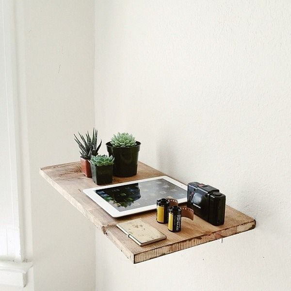 Simple raw wooden shelf. I think a few of these in the corner would look so nice to display décor and a bit of storage