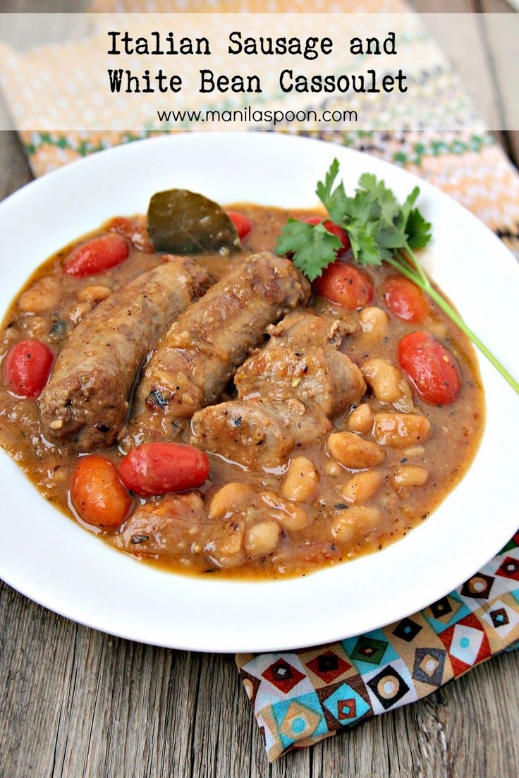 Loads of Italian sausages, tomatoes, herbs and white beans give full flavor to this hearty and delicious stew. #cassoulet