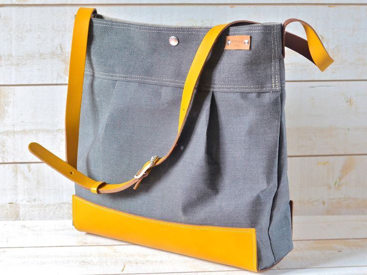 Waterproof  Messenger Bag / Diaper bag / Travel bag / Black Gray Striped Large Purse / Mustard Leather strap handbag /waterproof / Fashion by ikabags on Etsy https://www.etsy.com/listing/169340059/waterproof-messenger-bag-diaper-bag