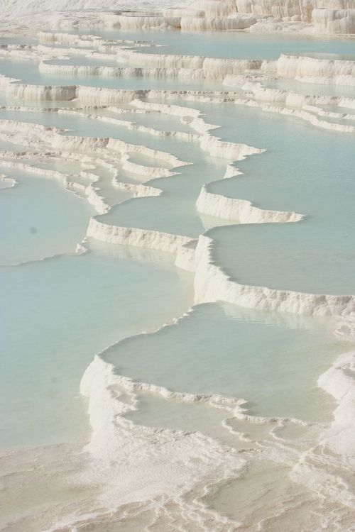 Pamukkale Turkiye, thermal pools, salt terraces: Pamukkale Turkiye, thermal pools, salt terraces. Pamukkale ('cotton castle' in Turkish) is a natural site in Denizli Province, Turkey, containing hot springs and travertines, terraces of carbonate minerals left by the flowing water. People have bathed in its pools for thousands of years.