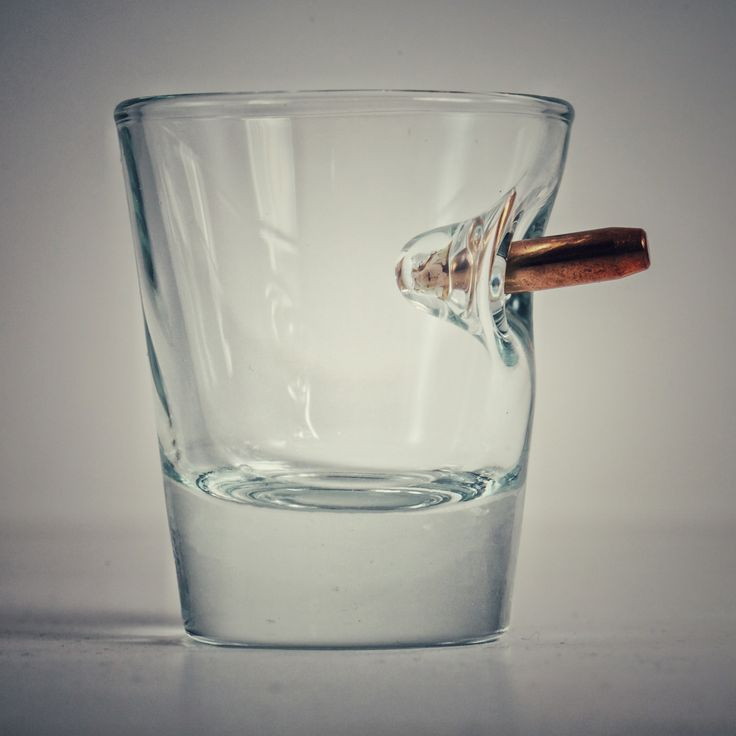 Custom shot glass with real bullet. Glass is high-quality, heavy, and  handcrafted in our glass workshop in Wisconsin.1.5 oz shot glass with  embedded bullet.  Each shot glass is unique. Made in the USA.  Our custom shot glasses are made when you order.  Make great gifts for hunters and military personnel!