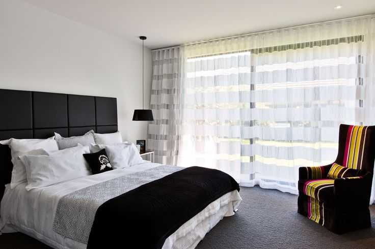 A glass slider here takes full advantage of the outside area. While this side of the bed contains a large walk-in wardrobe and an elegant ensuite
