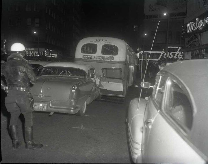 Downtown Oakland circa 1950. Key System bus number 2118 rear ended by auto.