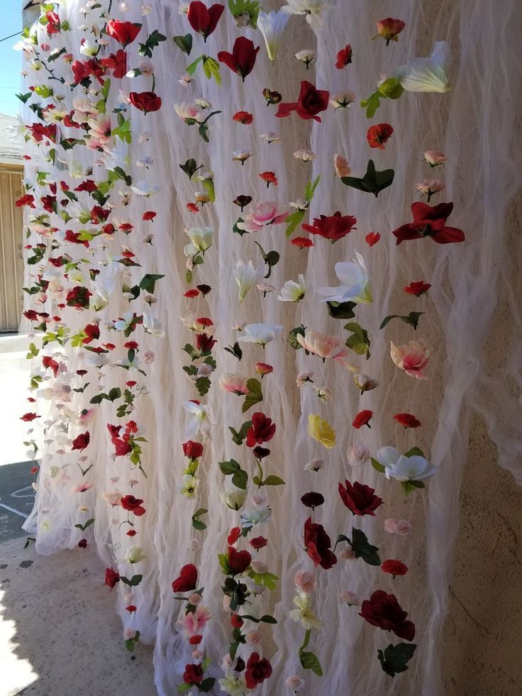 Engagement Party Flower Wall Decor. I bought a bunch of flowers at Dollar Tree, used fish string and it took me about 4 days to make. I'm sure it can take less depending on how long and how fast you work on it