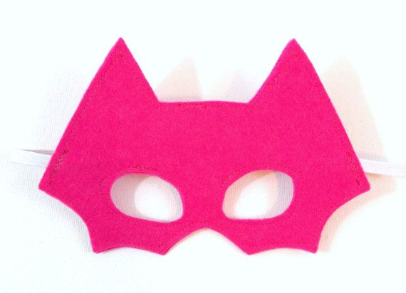 This listing is for one batman inspired mask--child size. The mask is made out of pink felt.    Message me to set up a custom reserved listing.