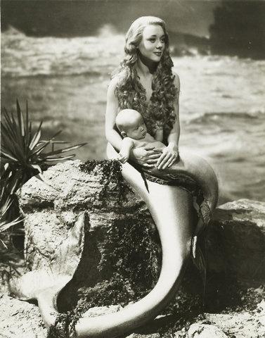 Beautiful Mermaid and child.