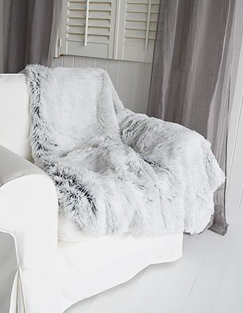 Gorgeous grey faux fur throw to snuggle up under on chilly days