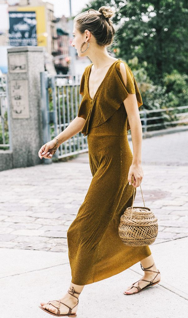 Dress down a sparkly dress with neutral sandals and a basket bag