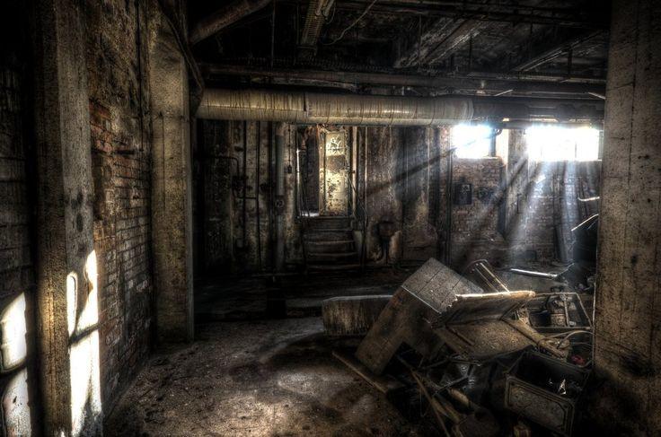 Underground Dark room with broken objects stuck in a pile.