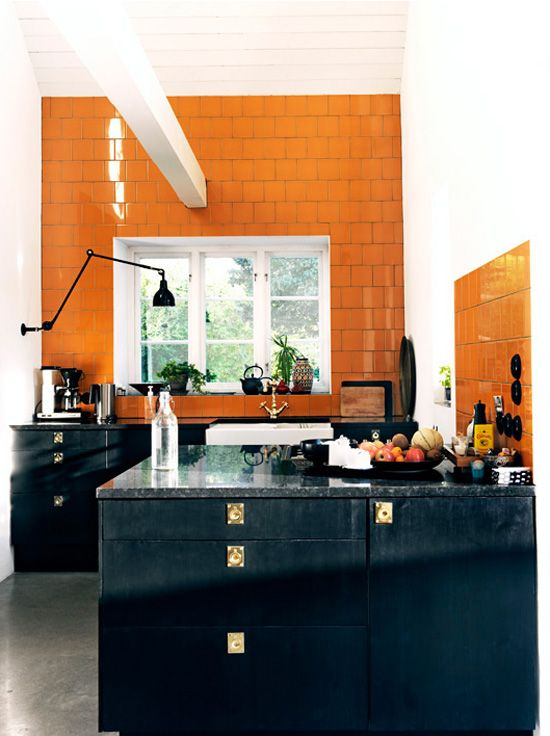 Love the contrast of the orange #tile and black cabinets. by Jonas Ingerstedt