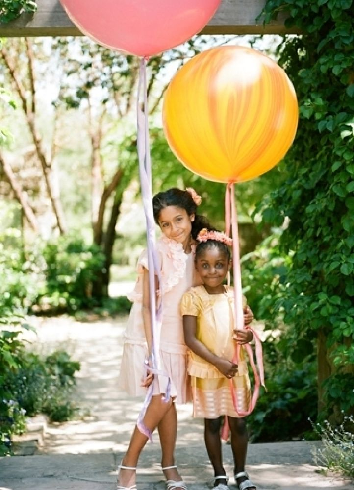 """Alternative to flower girl petal toss: balloon(s) in whatever colors you like! Also like the little """"ribbon crown"""" that matches ribbon on balloon. Lilla would loooove that."""