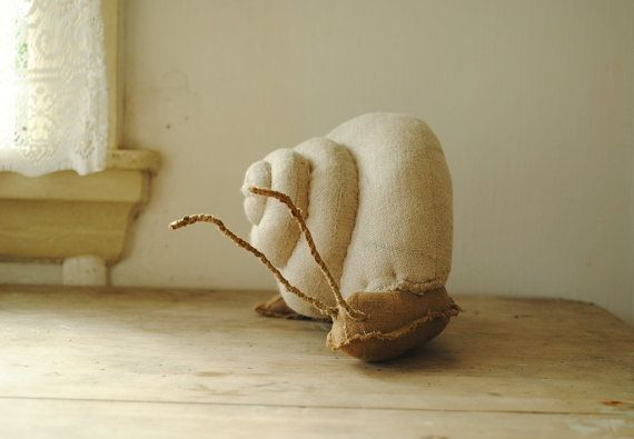 A very big snail soft sculpture handmade in Australia from salvaged linen remnants.    Im fascinated by snails beautiful shape and they way they touch