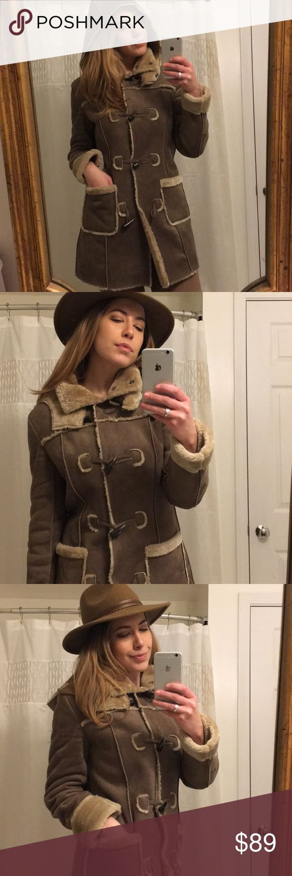 """Hive & Honey Faux Shearling Coat in Latte Worn twice! And each time I was stopped and asked where I got this faux fur! It gives you all the look of a suede and fur shearling coat with none of the cruelty and all the beautiful creamy color! Amazing button details (hidden snaps as well). Removable hood. Pockets!! And if you really need to bundle up, you can (see the last pic). Comes to my mid thigh (I'm 5' 8""""). Polyester. Size: M. Hive & Honey Jackets & Coats"""