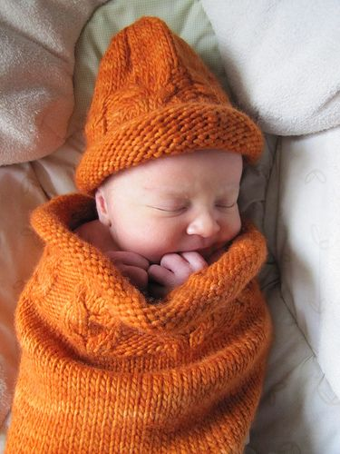 snuggly cocoon for baby free knitting pattern with owl cables