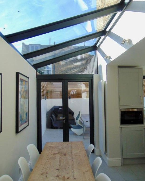 A French Door With Virtually Frameless Fixed Shaped Window Connecting Onto A Framed Lean To Glass Roof Glass Roof Extension Kitchen Extension Glass Glass Roof