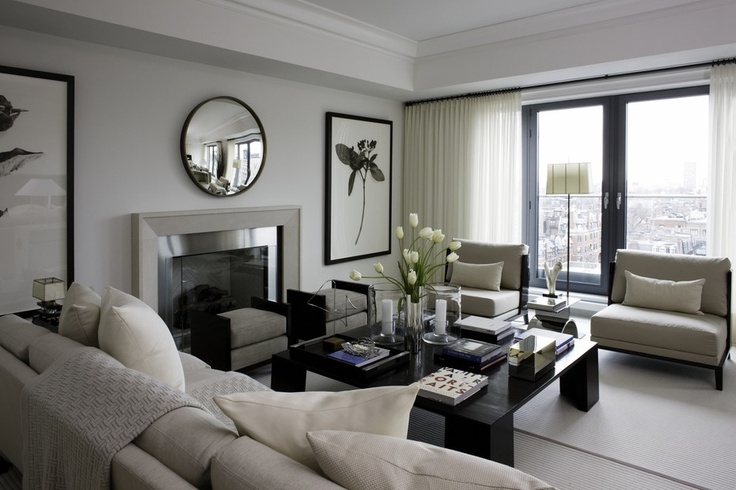 Monochromatic living room design with sleek, classic fireplace.