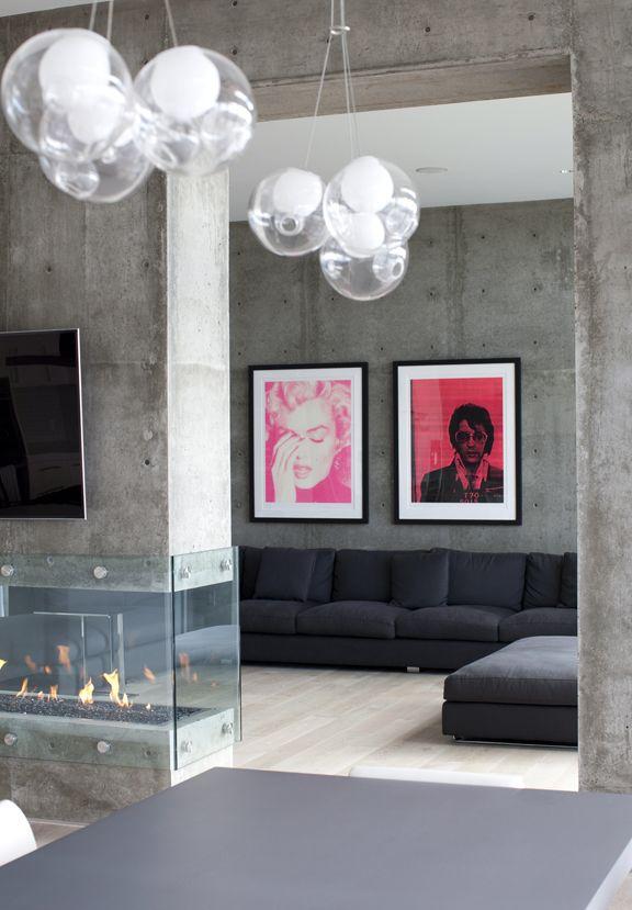 Concrete interior, bright pops of colour. Love.: