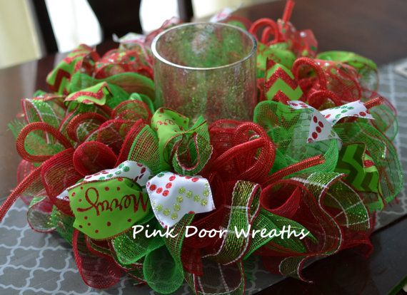 1 CHRISTMAS table centerpiece    Made with premium red and lime green mesh and accented with red, lime green and white ribbon. Measures
