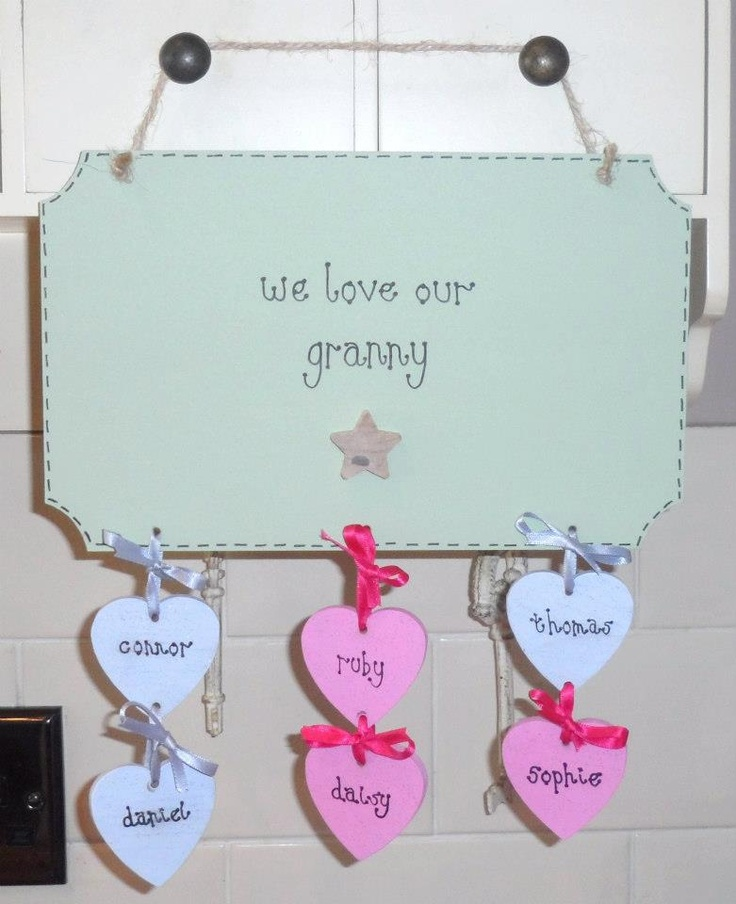 Family plaque with hanging hearts