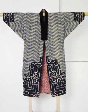 Brooklyn Museum: Asian Art: Man's Ceremonial Robe. In the nineteenth century, the Ainu began to use old Japanese kimonos, to which they added dark strips around the neck, front opening, sleeves, and hem. They decorated these additions with embroidery that became more complex over time. The cutwork in the dark edge fabric on this man's coat allows for a sophisticated dialogue between traditional Ainu embroidery forms and the bold pattern of the Japanese textile below.