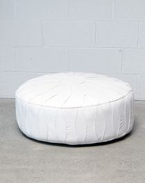 white pouffe. White leather ottoman. Republic. Places and Graces.
