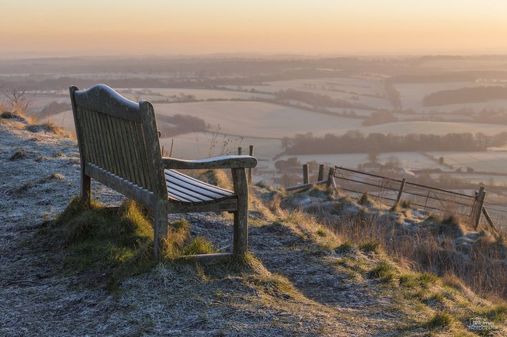 JRTurnerPhotography posted a photo:  The bench up on Martinsell Hill looking over the Vale of Pewsey on a freezing cold morning in January.  Canon EOS 5D Mark III|16-35mm F4 L  I've been teaching Poppy photography, take a look at her Flickr .  Facebook | Twitter | Website