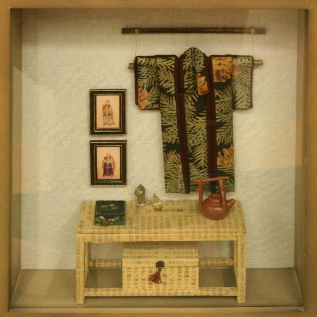 A display of Japanese miniatures in a deep picture frame exhibited by Kristine Hill at the Fall 08 Seattle Dollhouse Show.