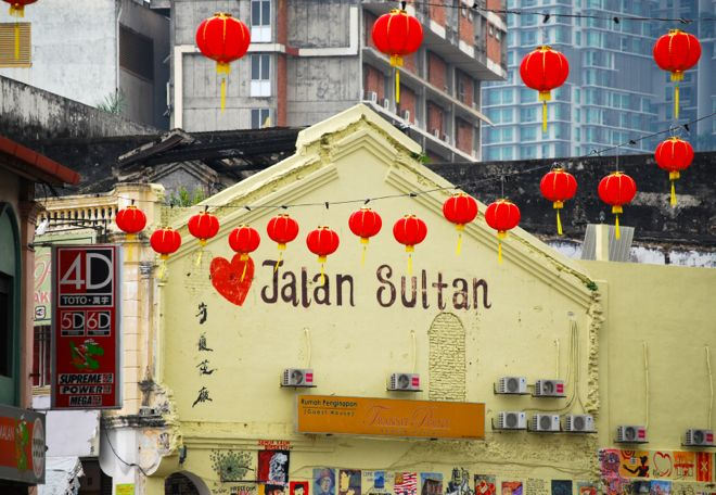 If you've ever been to Asia, this is the quintessential picture that captures all its complexities. Chinese lanterns with Malay words. Modern skyscrapers behind heritage colonial shops. Welcome to Kuala Lumpur, a city that has a bit of everything. Find out more here: http://www.suitcasesandstrollers.com/articles/view/asia-holiday-destinations-kl-with-kids?l=all #suitcasesandstrollers #travel #travelwithkids #familytravel #familyholidays #familyvacations