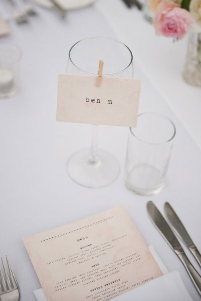 place card clipped to a wine glass with a mini clothes pin