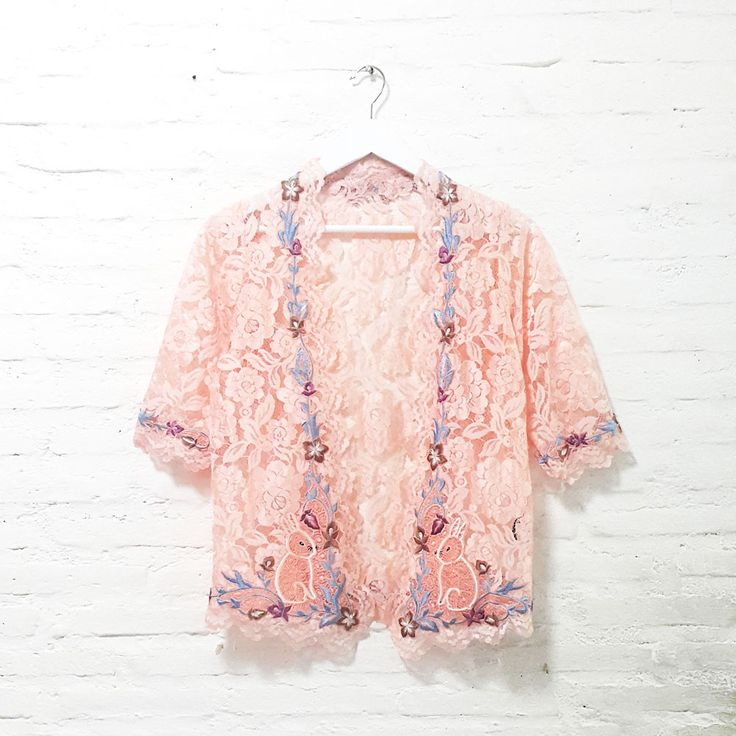 Lulu Rabbit Lace 001  IDR 895.000   Open for Pre-Order  Estimated Work Days : 7 – 10 working days  Lulu Rabbit Hand Embroidery Contemporary Kebaya Lace  Length of Kebaya : approx. 65 cm  Material used : Fine Lace / Hand Embroidery  Free Size (Bust up to 102 cm)  Length of Sleeve : approx. 38 cm