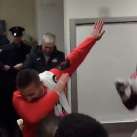 Urban Meyer dabbed in the locker room after Ohio State crushed Michigan