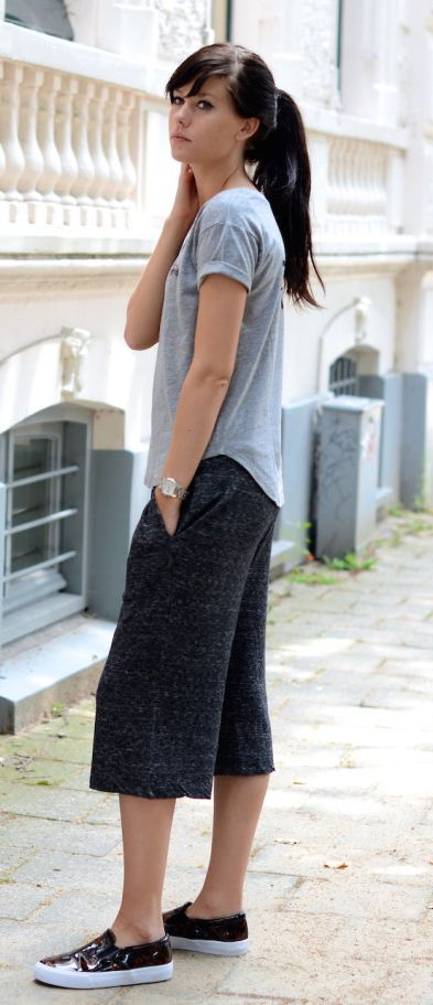 Lucy de Boer is wearing culotte shorts, shirt and shoes all from ASOS