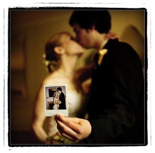 wedding photo... hold origingal kissing pic while kissing at vow renewal!