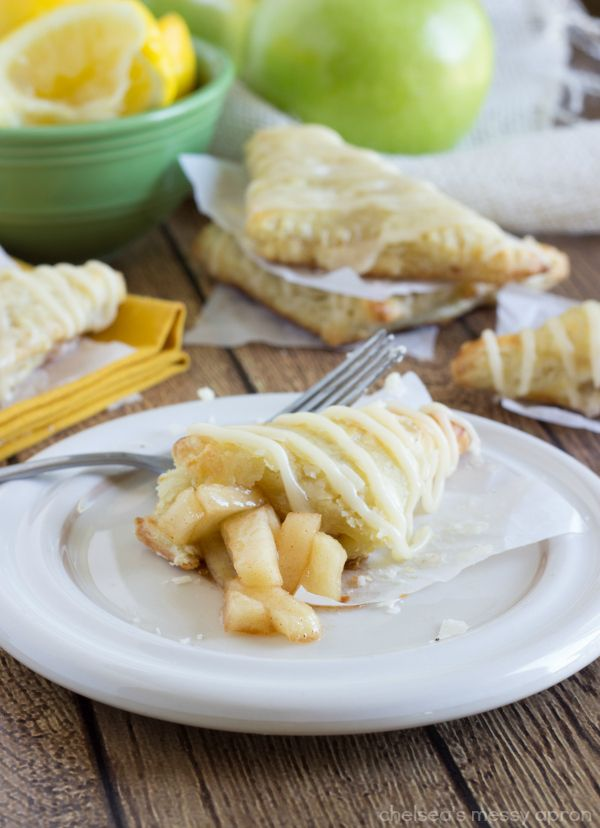 Incredibly simple apple turnovers made mini. These apple turnovers are made with a puff pastry, filled with sugared apples, and coated in a cream cheese glaze. The perfect breakfast, brunch, or sna...