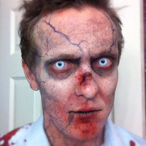 Zombie makeup, love the veins in this face creating a very evil and deceased look. The veins in the face draw attention to the contact lenses in the eyes which makes it more zombie and obscured. The use of small cuts is also an interesting look as not much of the face is bloody but it more detailed in other ways instead.