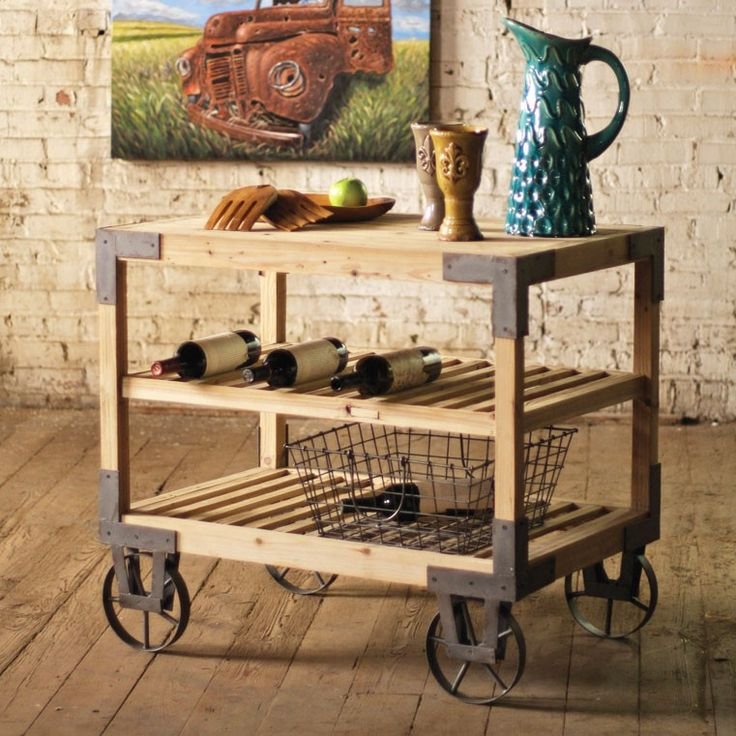 Display your fine barware, flavored libations, and decorative accents on this handsome and rustic rolling bar. The shelves and frame are made from sturdy wood in a natural tone. Metal accents and casters complement the wood and add their own remarkable character.