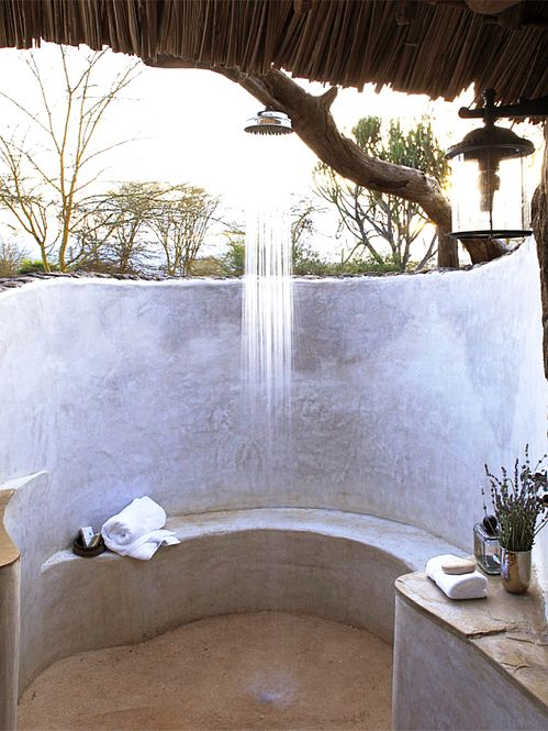 outdoor shower with stucco bench privacy wall