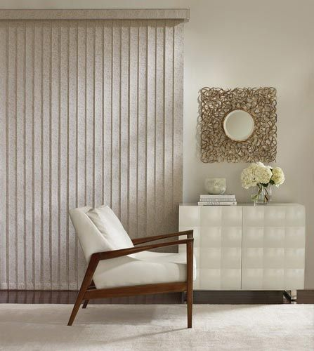 Hunter Douglas Vertical Blinds can range from sleek, contemporary designs to translucent curved vanes, ideal for wide windows and sliding-glass doors,