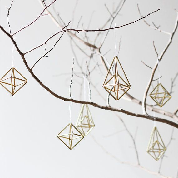 Finnish traditional style combined with geometric shapes - Just imagine purple branches paired with the gold of the ornaments!!!