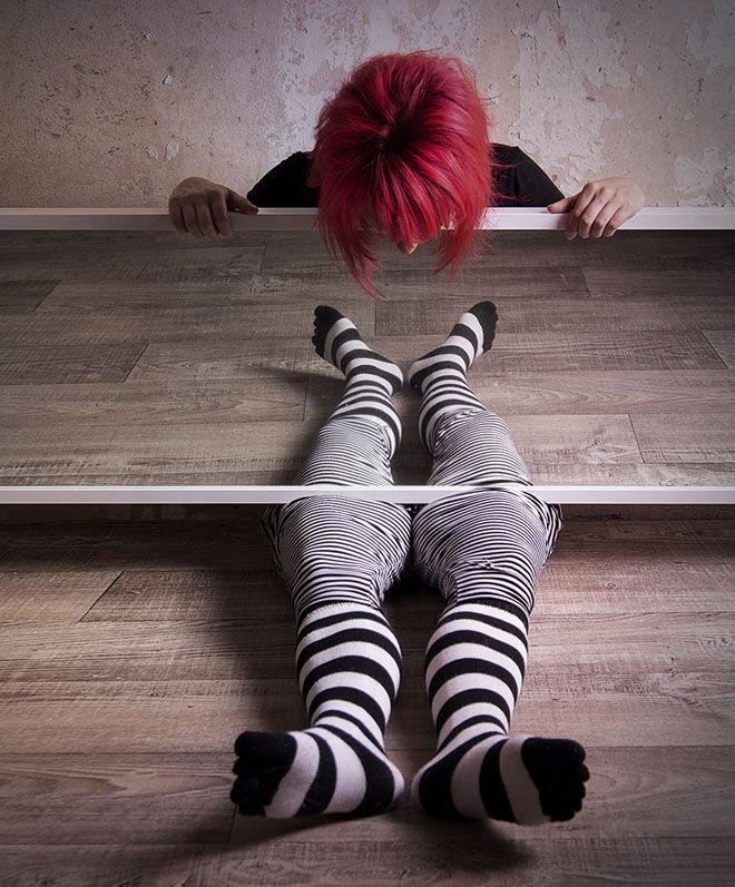 This photo is visually interesting. It captures the girls body split in half and capturing the reflection of her legs in the mirror.