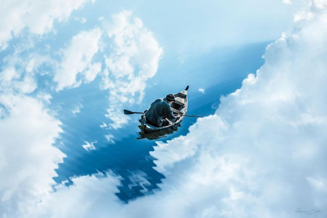 Using photoshop to create a magical photo of a man rowing into the clouds