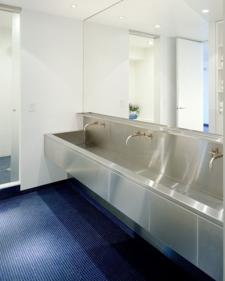 NY loft by Delson Sherman, trough like stainless steel sink in children's bathroom | Remodelista