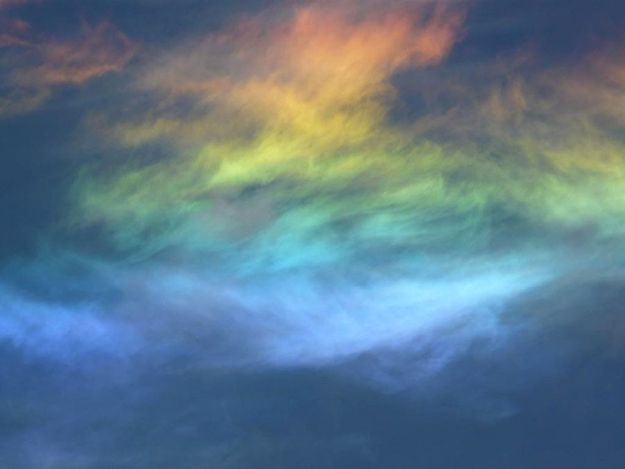 Circumhorizontal arcs, or fire rainbows as they're commonly known, is an optical phenomenon caused by plate-shaped ice crystals in cirrus clouds