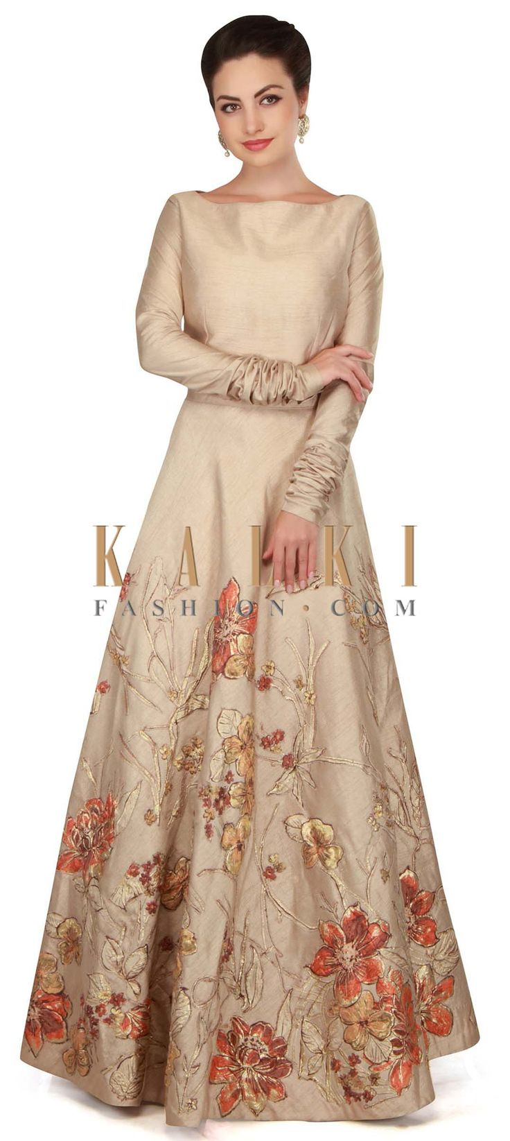 Oyster cream gown in applique floral embroidery only on Kalki