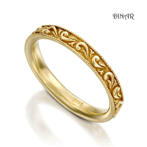 18k solid gold ring gold color available to choose: white/ yellow /rose  A Thin & delicate Vintage style wedding ring ,  Antique style leafs scrolls engravings, milgrain on the border lines, The beautiful scrolling leafs pattern encircles the band.  ----------------------DETAILS-------------------------- for the 14k solid gold band see this link: https://www.etsy.com/il-en/listing/503793656/thin-scrolls-band-14k-gold-stack-ring   ***Designed for wom...