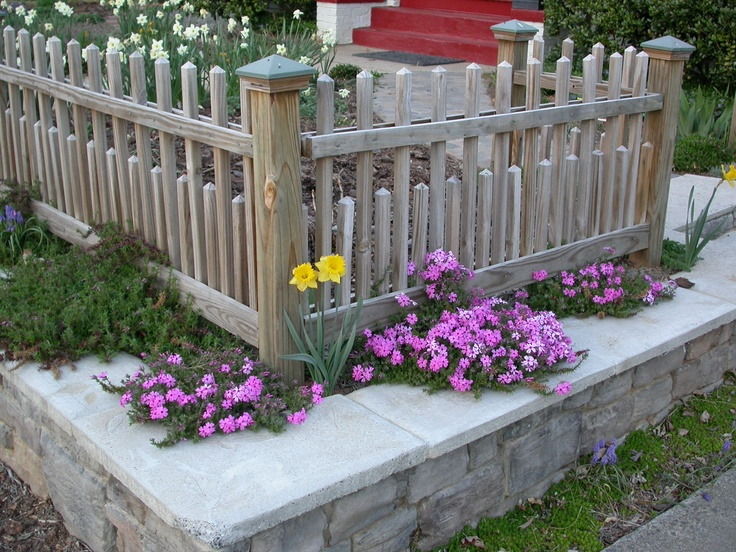 Front Fence with Retaining Wall Garden and Flowers