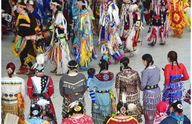 A colourful display from dancers in the Grand Entry during the 34th Annual Ben Calf Robe Traditional Pow Wow at the Commonwealth Rec Centre in Edmonton, May 9, 2015.