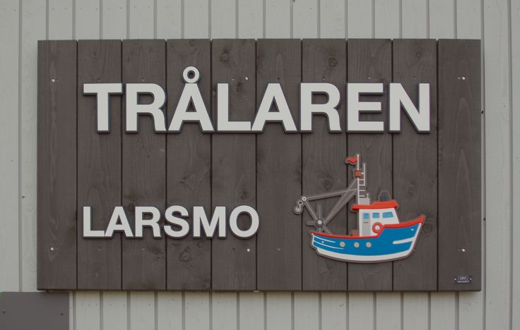 Sign for a pre-school, Larsmo, Finland. Iron sulphate treated spruce and HDU.
